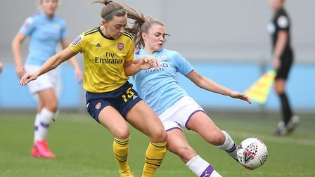 Manchester City's Georgia Stanway (right) and Arsenal's Katie McCabe battle for the ball during the