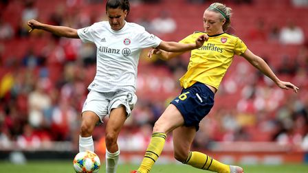 Bayern Munich's Jovana Damnjanovic (left) and Arsenal's Louise Quinn (right) battle for the ball dur