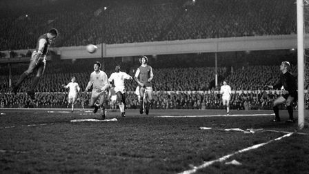 John Radford soars into the Highbury air to head Arsenal's second goal watched by admiring teammate