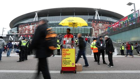 A programme seller before the Premier League match at the Emirates Stadium, London. Picture: Jonatha