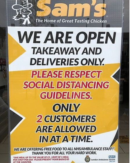 Posters at Sam's chicken shop in Kingsbury promising NHS workers a free meal. Picture: Tom Christou