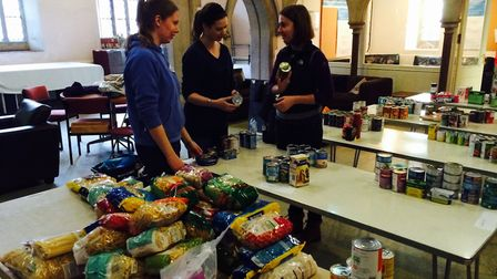 Natalie Stewart, Bryony Hirsch and Kim Staines in final preparations for The Hive Food Bank, which w