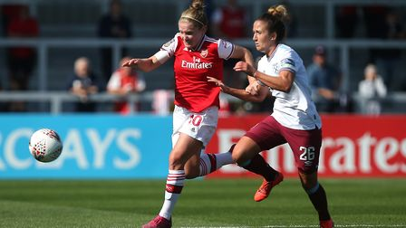 Kim Little of Arsenal and Laura Vetterlein of West Ham battle it out (pic Gavin Ellis/TGS Photo)