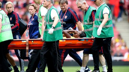 Arsenal's Danielle Carter leaves the pitch on a stretcher during the Emirates Cup match at the Emira