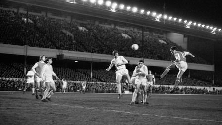 Arsenal's George Graham (far right) jumps and heads his teams fourth goal past Dynamo Bacau. Picture