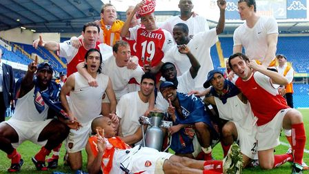 Arsenal players celebrate after clinching the Barclaycard Premiership title following a 2-2 draw wit