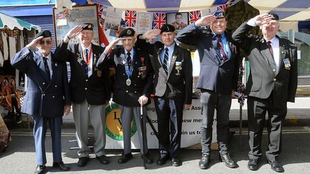 Pictured from left by their stall is Ron Goodere, Ken Watts, Bill Millett MBE, Ernie Welsh, Mark S