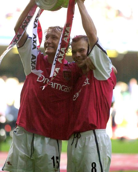 Arsenal's Ray Parlour (left) and Fredrik Ljungberg celebrate with the FA Cup after netting in the 2-