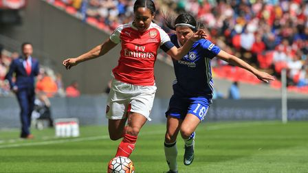 Arsenal's Alex Scott (left) and Chelsea's Ana Borges battle for the ball during the SSE Women's FA C