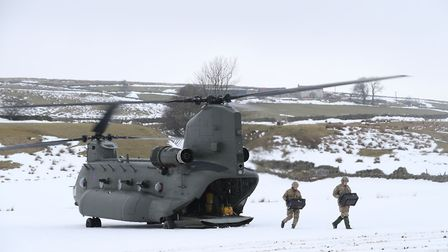 A RAF Chinook helicopter is used in the heavy snow. Photograph: Owen Humphreys/PA.