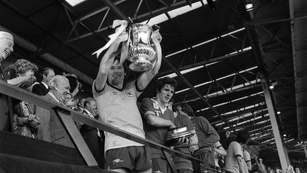Arsenal skipper Pat Rice holds aloft the FA Cup after the 1979 final at Wembley