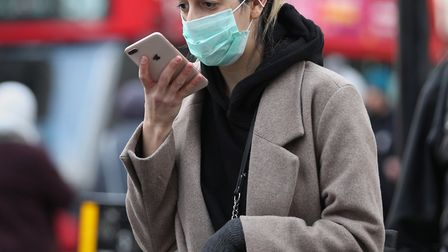 A woman wearing a face mask mask in Oxford Street in London, as the Government's top scientist warne
