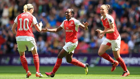Arsenal's Danielle Carter (centre) celebrates scoring her side's first goal during the SSE Women's F