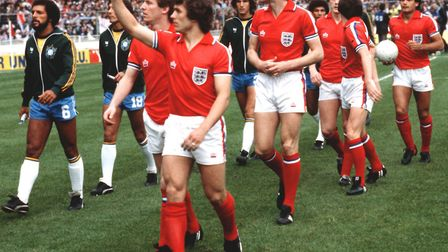 Kenny Sansom waving to the crowds as England walk out before a match against Brazil at Wembley