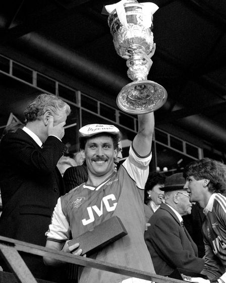 Arsenal captain Kenny Sansom lifts the Littlewoods Cup after his team's 2-1 win over Liverpool in th