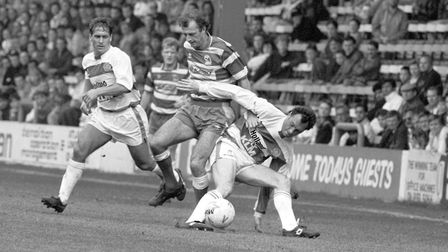 Trevor Francis (centre) in action for Sheffield Wednesday with Queens Park Rangers' Kenny Sansom (le