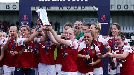 Arsenal women's club captain Jordan Nobbs and captain Kim Little celebrate with the trophy after the