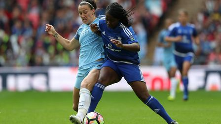 Manchester City's Lucy Bronze (left) and Birmingham City's Freda Ayisi battle for the ball during th