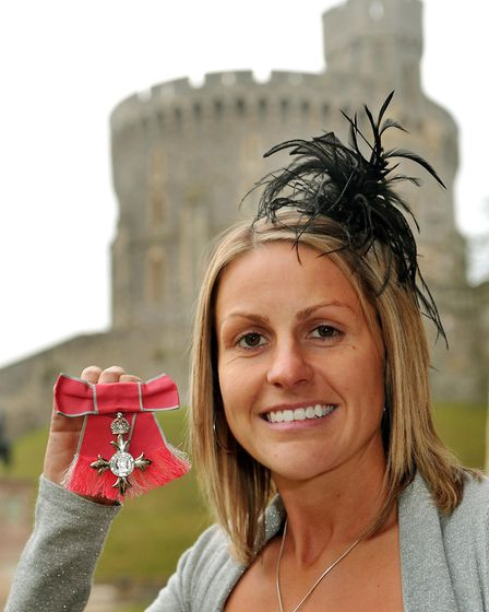 Kelly Smith, Arsenal and England Ladies footballer, proudly holds her MBE in the grounds of Windsor