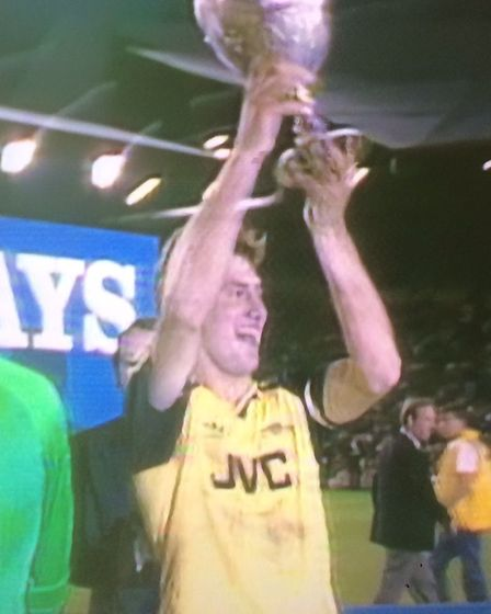 Arsenal captain Tony Adams lifts the First Division trophy at Anfield on May 26, 1989