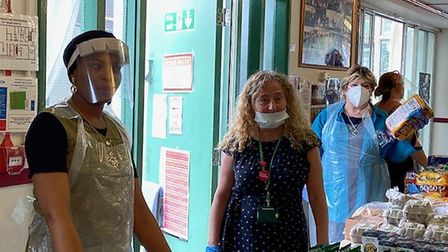 Islington South and Finsbury MP Emily Thornberry and Cllr Una O�Halloran volunteering at the food ba