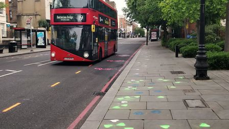 Islington XR activist used stencils to paint a new cycle lane outside Islington Town Hall in Upper S