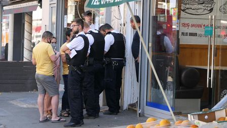 Police talk to witnesses after man seen with a gun in Kilburn High Road. Picture: David Nathan