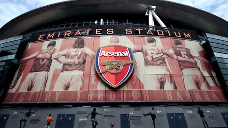 A lone jogger runs past the Emirates Stadium, home of Arsenal