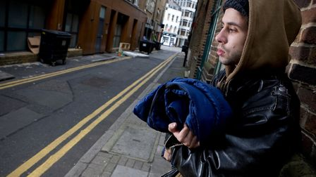 Rough sleeper illustrated in Crisis charity's campaign by model with sleeping bag. Picture: Sam Mell