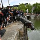 Protesters throw statue of Edward Colston into Bristol harbour during a Black Lives Matter protest r