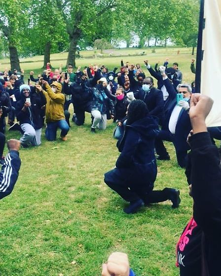 Dawn Butler and communities take to their knee in Roundwood Park as part of Black Lives Matter. Pict