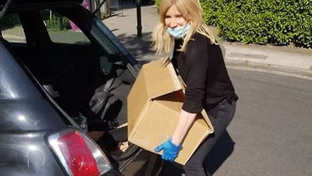 Michelle Collins delivering food. Pictured: Michelle Collins