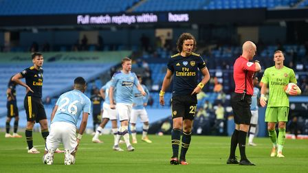 Arsenal's David Luiz (third right) walks off the pitch after being shown a red card for a challenge