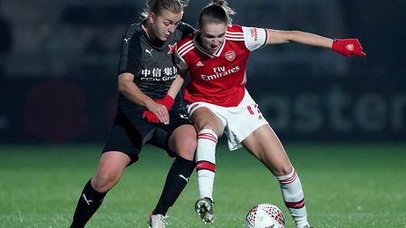 Arsenal's Vivianne Miedema (right) is tackled during the UEFA Women's Champions League round of 16 s