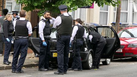 Police in Church End following an alleged car chase. Picture: David Nathan