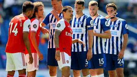 Brighton & Hove Albion and Arsenal players stand together prior to a corner being taken during the P