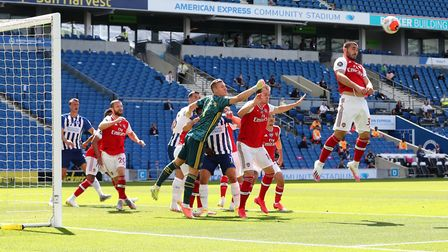 Arsenal's Sead Kolasinac clears a corner during the Premier League match at the Amex Stadium