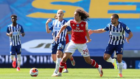 Arsenal's Matteo Guendouzi and Brighton's Neal Maupay (right) battle for the ball during the Premier