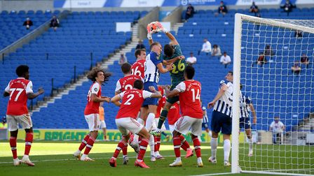 Arsenal goalkeeper Emiliano Martinez claims the ball in the penalty area during the Premier League m