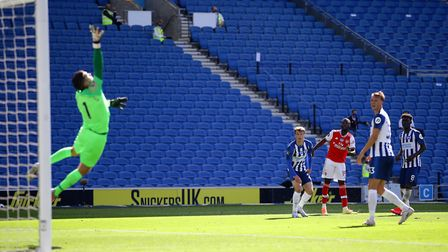 Arsenal's Nicolas Pepe scores the opening goal of the Premier League match at the Amex Stadium