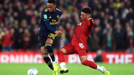 Arsenal's Joe Willock (left) and Liverpool's Alex Oxlade-Chamberlain battle for the ball during the
