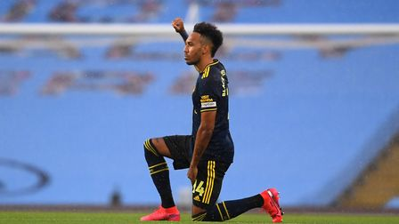 Arsenal's Pierre-Emerick Aubameyang takes a knee in support of the Black Lives Matter movement befor