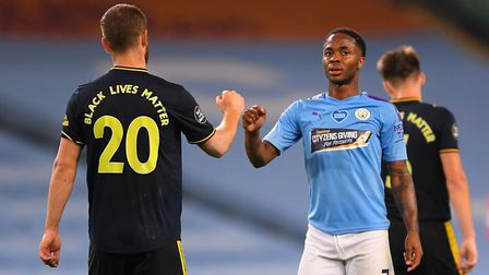 Arsenal's Shkodran Mustafi and Manchester City's Raheem Sterling after the Premier League match at t