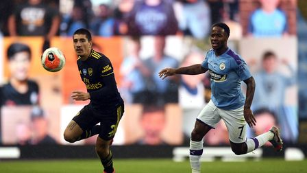 Arsenal's Hector Bellerin (left) and Manchester City's Raheem Sterling battle for the ball during th