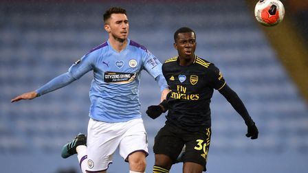 Manchester City's Aymeric Laporte (left) and Arsenal's Eddie Nketiah battle for the ball during the