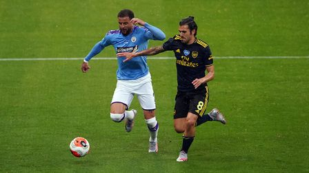 Manchester City's Kyle Walker and Arsenal's Dani Ceballos challenge for the ball during the Premier