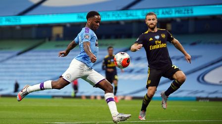 Manchester City's Raheem Sterling scores the opening goal during the Premier League match at the Eti