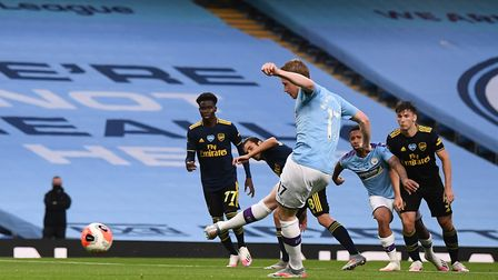 Manchester City's Kevin De Bruyne scores his side's second goal of the game from a penalty during th