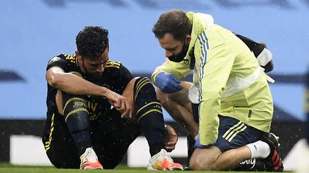 Arsenal's Pablo Mari receives treatment before being substituted with an injury during the Premier L