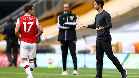 Arsenal's Cedric Soares receives instructions from manager Mikel Arteta